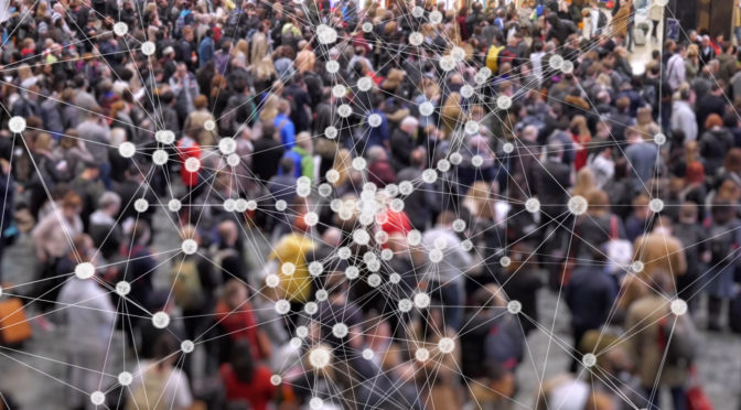 Coronavirus particles spreading in a crowd of people.